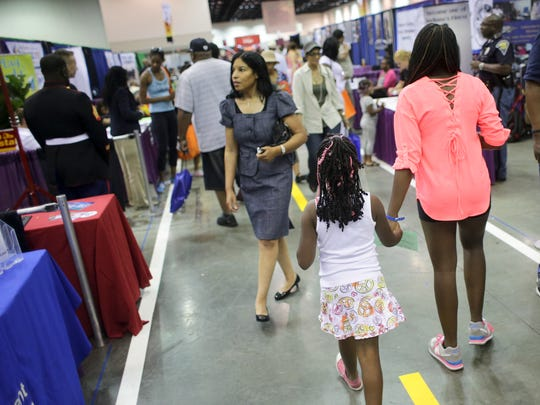 Attendees browse the displays that the 2013 Indiana Black Expo Summer Celebration at Indiana Convention Center.
