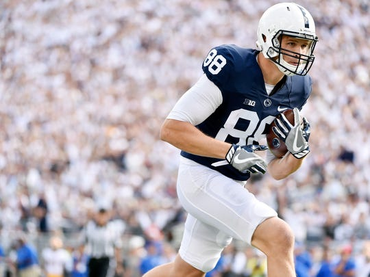 Penn State's Mike Gesicki carries the ball into the end zone for an 8-yard touchdown in the first half of an NCAA Division I college football game Saturday, Sept. 9, 2017, at Beaver Stadium. Penn State defeated Pitt 33-14.