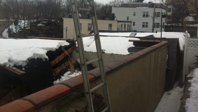 A roof collapsed on a two-story building in Yonkers on Tuesday.