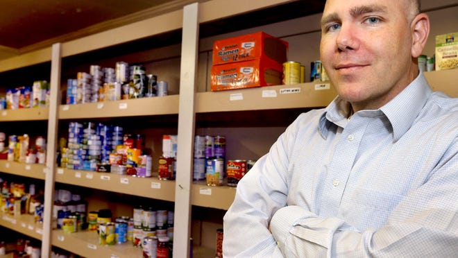Taylor Loyal, Rutherford County Development manager for Second Harvest Food Bank of Middle Tennessee, stands in the food pantry at Greenhouse Ministries. The aid agency is partnering with the Rutherford County/Smyrna Chamber of Commerce.