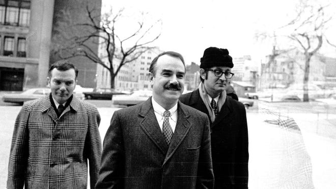 Three defendants, including G. Gordon Liddy (center), arrive at court for trial in the Watergate case in 1973.