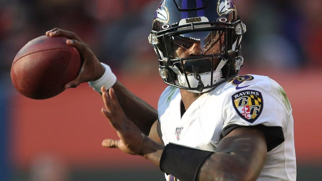 Baltimore Ravens quarterback Lamar Jackson looks downfield for a receiver during a game last season against the Browns.