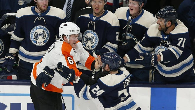 Blue Jackets center Nathan Gerbe, right, fights with Flyers defenseman Travis Sanheim during a game on Feb. 20.