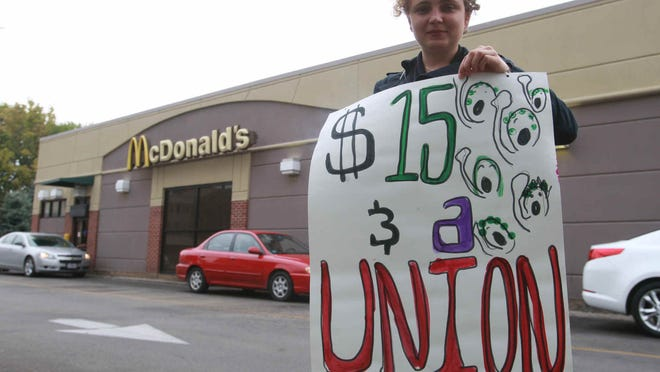 SEIU member Maddalena Bandyk and other members of the Service Employee International Union, gathered at the McDonalds at 16th and Meridian streets to protest wages by fast food companies.