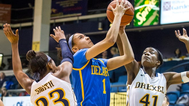 Delaware's Chastity Taylor puts up a shot between Drexel's Alexis Smith (No. 23) and Jamila Thompson (No. 41) during UD's loss in Philadelphia on Sunday.