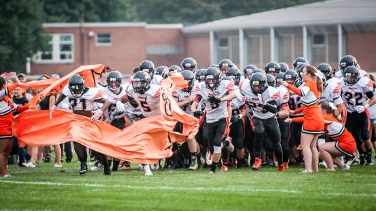 Northeastern players run through a banner while making their entrance for the first game of their YAIAA football season on Friday, September 4, 2015. Jeff Lautenberger Ñ For GameTimePA.com