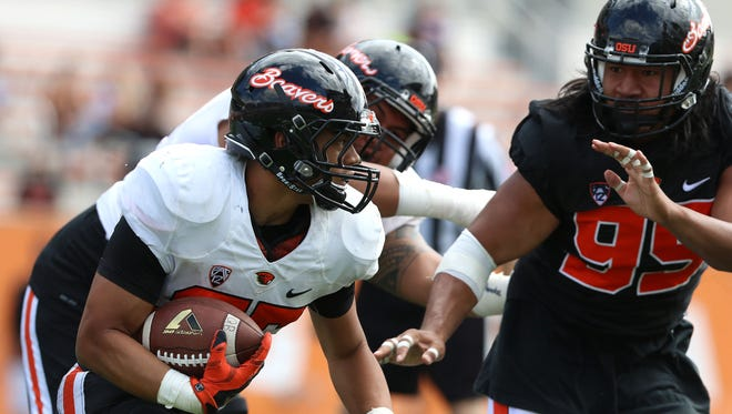 Oregon State running back Jaylynn Bailey runs the ball during a scrimmage on Saturday, Aug. 15, 2015, in Corvallis, Ore.