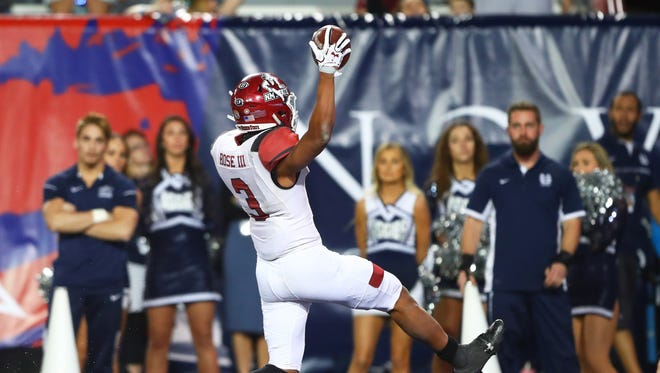 Dec 29, 2017; Tucson, AZ, USA; New Mexico State Aggies running back Larry Rose III (3) scores the winning touchdown in overtime against the Utah State Aggies in the 2017 Arizona Bowl at Arizona Stadium. Mandatory Credit: Mark J. Rebilas-USA TODAY Sports