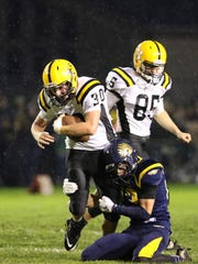 Cascade's Garrett Coffey runs the ball as the Cougars defeat Stayton 31-7 in an Oregon West Conference game Friday.