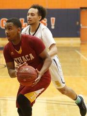 Jamar Nembhard of Ithaca drives toward the basket as Nicholas Guzman of Pine Bush defends Tuesday during a Class AA boys regional semifinal at Orange County Community College.