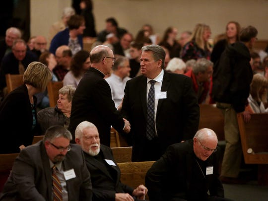 During a Week of Prayer for Christian Unity hundreds attended an Ecumenical worship service at St. Elizabeth Ann Seton Catholic Church Wednesday, January 18. Dr. Mark Hausfeld, President Assemblies of God Theological Seminary, right, and Bishop Edward Rice, give each other a handshake of peace.