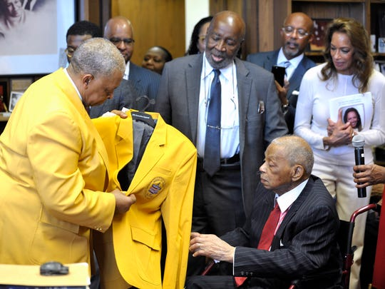 William Thurman, left, chairman of the National Civil Rights Hall of Fame, in Chicago, presents Judge Damon Keith with a charter member gold blazer.
