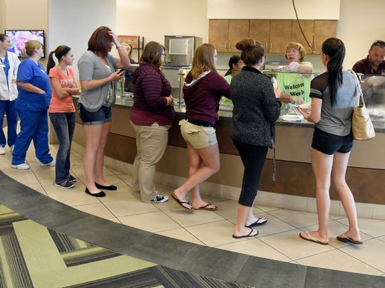 Ivy Tech students line up for breakfast during the first day of classes at Ivy Tech Community College Southwest in Evansville Tuesday.