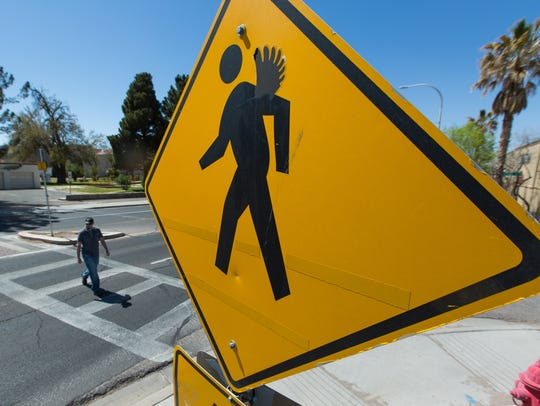 A person is seen crossing a Las Cruces crosswalk in this March 2016 file photo. Outfitted in superhero costumes, Las Cruces police issued 60 citations Thursday, March 14, 2019 to drivers in two enforcement operations; more than half of the citations were for failing to yield to pedestrians crossing two separate crosswalks. Police warned that further enforcement operations are planned.