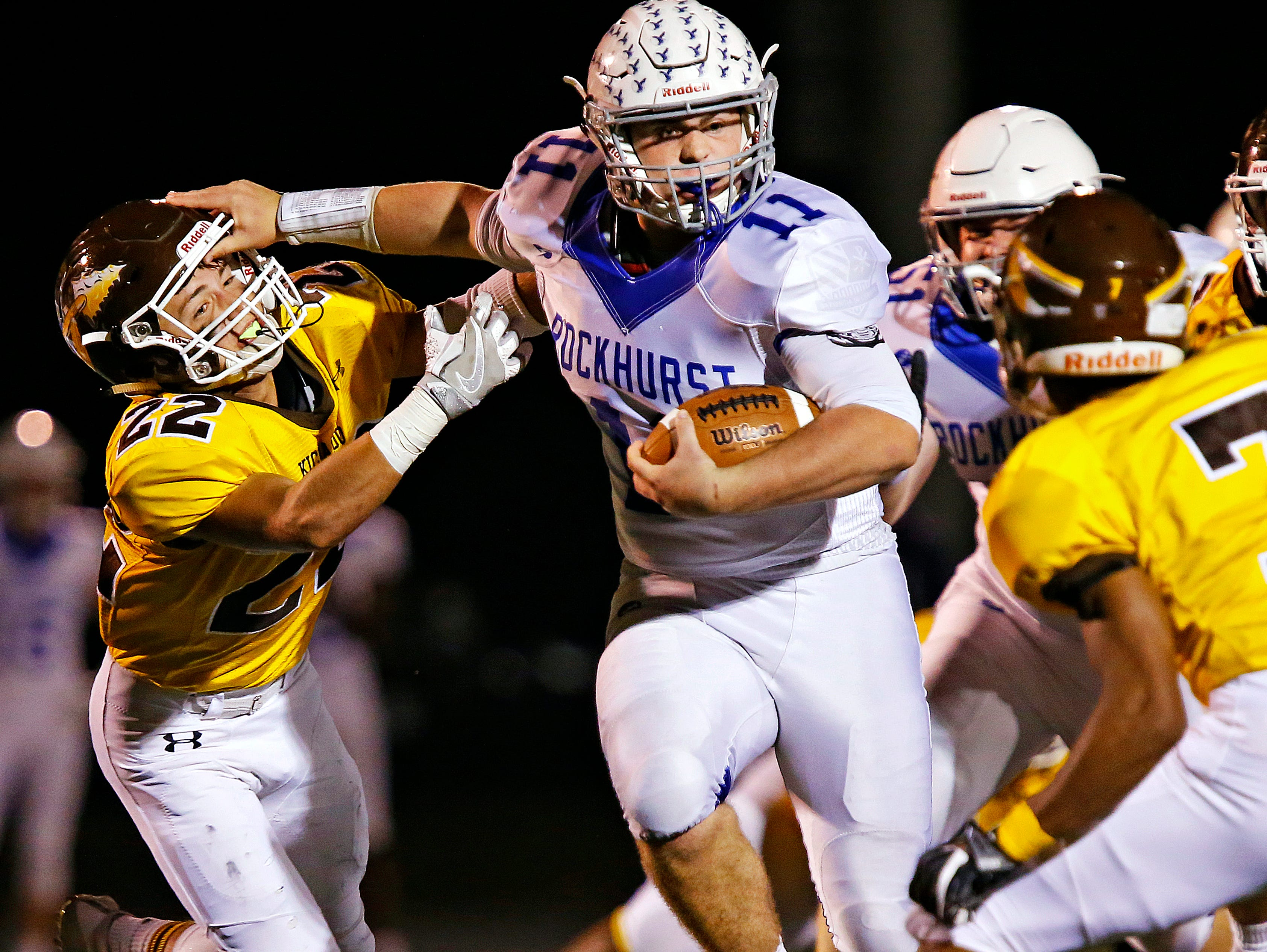 Rockhurst High School quarterback Chance May (11) stiff arms Chiefs wide receiver Cole McCarville (22) during first quarter action of the Class 6 playoff game between Rockhurst High School and Kickapoo High School played at Pottenger Stadium in Springfield, Mo. on Oct. 28, 2016.
