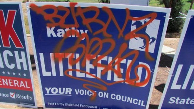 A Littlefield campaign sign was marred by graffiti.
