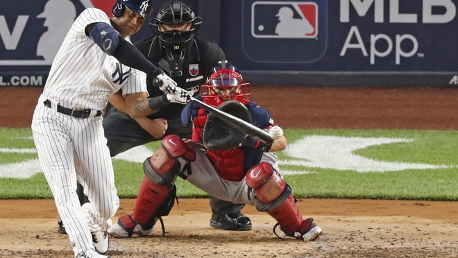 New York's Aaron Hicks connects for a second-inning, RBI double Sunday night against Boston. The Yankees won, 4-2.