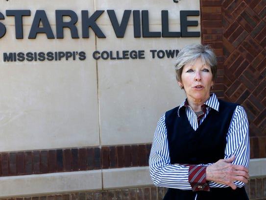 Standing outside her city hall office, Starkville Mayor