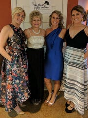 Gala committee Some events call for a multi-person leadership to manage all the details. Pictured at the recent Holy Rosary Gala at the Evansville Country Club are Jackie Gonterman Tri-chair, Christine Gilles development director, Stephanie Kennedy Tri-chair and Jessica Williams Tri- chair.