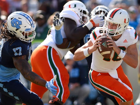 Miami Hurricanes quarterback Evan Shirreffs looks to