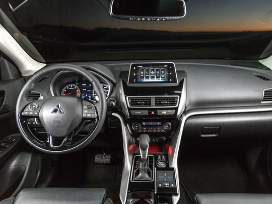 The touch screen is large and clear, but it stands up from the dash board for a look that's less integrated than vehicles that incorporate the screen into the center stack with audio and climate control.