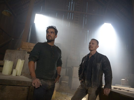 Father Tomas (Alfonso Herrera, left) and Marcus (Ben