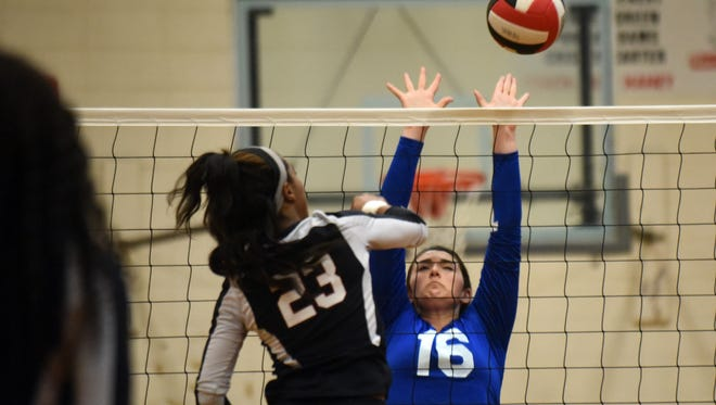 Sacred Heart's Anna Runnels attempts to block a hit from West Marion's India Sartin in Thursday's match.