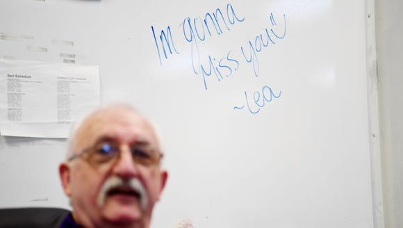 "A whiteboard behind Val Burch reads ""I'm gonna miss"
