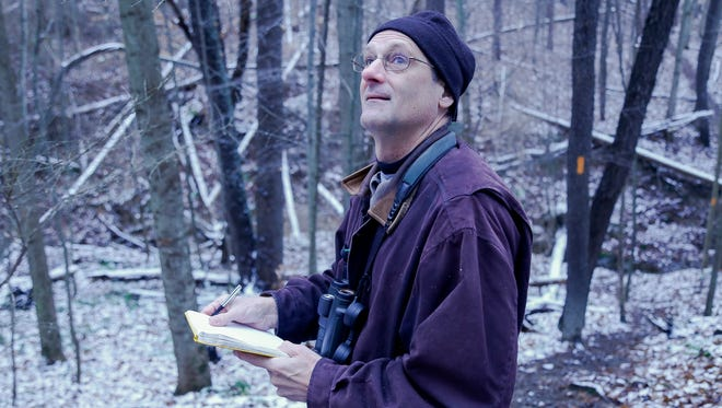 Jody Enck, of the Cornell Lab of Ornithology, writes down a species of bird spotted while participating in the Christmas Bird Count on January 1, 2016.