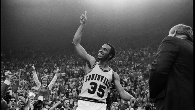 University of Louisville's Darrell Griffith celebrates after leading his team to the NCAA basketball championship over UCLA. By Barbara Montgomery, The Courier-Journal.  March 24, 1980.