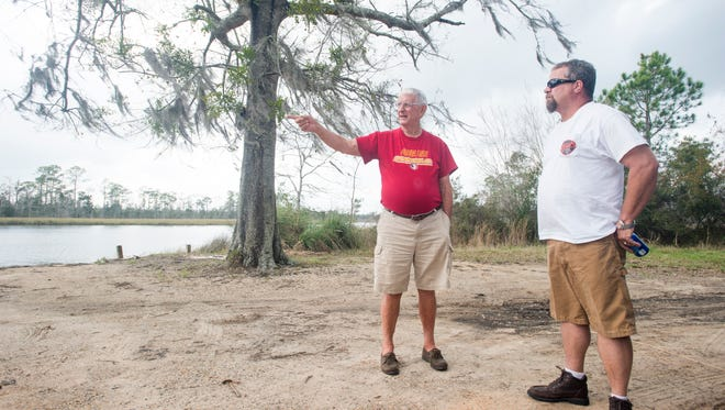 Local residents Bob Stewart, left, and Todd Bailey discuss their objections to the proposed commercial fishing facility at the end of Morrell Road in Milton on Wednesday, March 1, 2017.    This issue is being reviewed by Santa Rosa County Planning & Zoning.