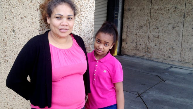 Maria Caballero, 41, and daughter Angie Johnson Caballero, 12, pose for a portrait shortly after appearing in immigration court in Memphis.
