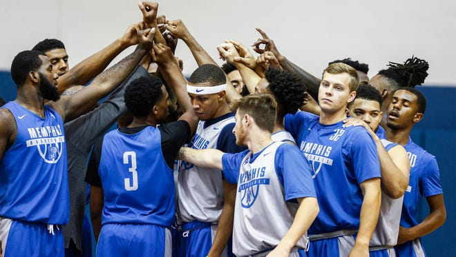 University of Memphis basketball huddles the together during their first practice of the 2017-18 season, Friday afternoon at the Larry O. Finch Center.