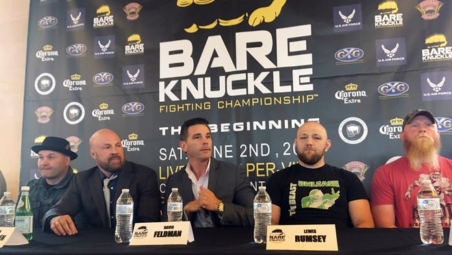 Promoter David Feldman, center, prepares for a news conference for a bare-knuckle boxing event scheduled for Saturday night at the Cheyenne Ice and Events Center in Wyoming. Wyoming is the first state to regulate and sanction bare-knuckle fighting, which promoters say was never done even during its heyday during the 18th and 19th centuries. From left are fighter Bobby Gunn; Bryan Pedersen, chairman of the Wyoming State Board of Mixed Martial Arts; Feldman, fighter Lewis Rumsey and fighter Sam Shewmaker.