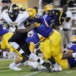The Byrd defense tries to wrap up Fair Park's Robert Rochell during their jamboree last week at Lee Hedges Stadium.