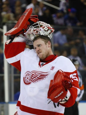 Jimmy Howard takes a break during the win over the Rangers.