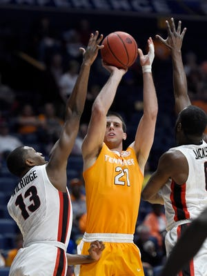 Tennessee forward Lew Evans (21) shoots against Georgia forward E'Torrion Wilridge (13) and guard William Jackson II (0) early in their game in the 2017 SEC Men's Basketball Tournament at Bridgestone Arena Thursday, March 9, 2017 in Nashville, Tenn.