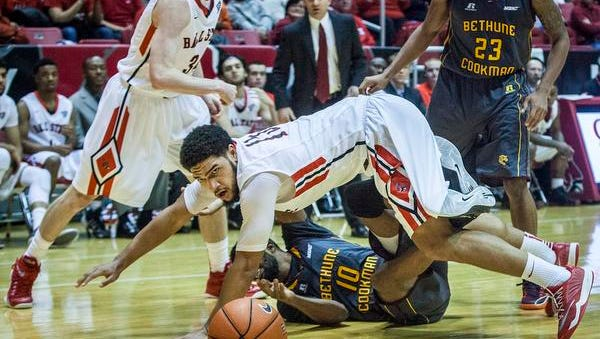 Ball State's Franko House struggles for possession against Bethune-Cookman's defense during their game at Worthen Arena Saturday. Ball State defeated Bethune-Cookman 51-48.