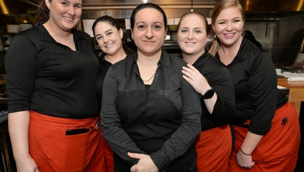 Carrabbas staff members Nicole Carlson, left, Cheyenne Gabrey, Proprietor Danielle Piazza, Erin Pawley and Stephanie Weppner.