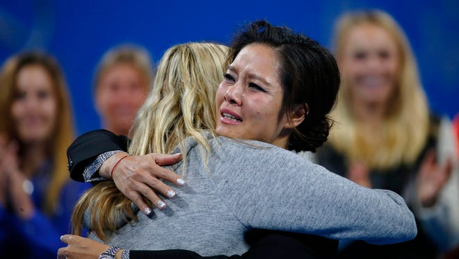 Tennis player Li Na (R) of China cries as she hugs Petra Kvitova of the Czech Republic during a retirement ceremony at the China Open tennis tournament in Beijing September 30, 2014. Li, Asia's only grand slam singles champion, announced her retirement from tennis earlier this month, succumbing to the effect of long-term knee injuries.
