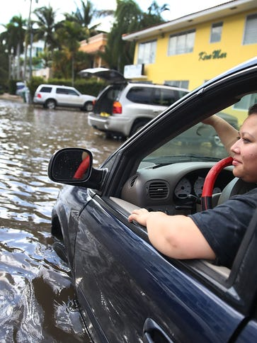 Sandy Garcia sits in her vehicle that was stuck in