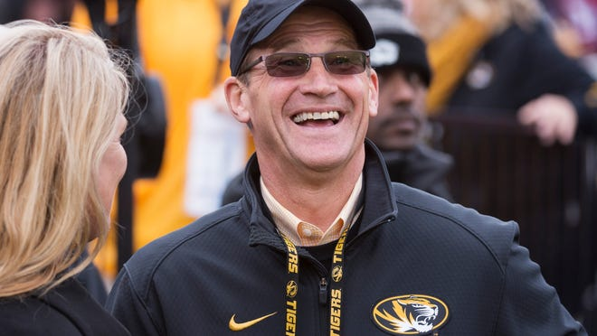 In this Nov. 25, 2016, file photo, Missouri athletic director Jim Sterk laughs on the sideline before the start of a football game against Arkansas.