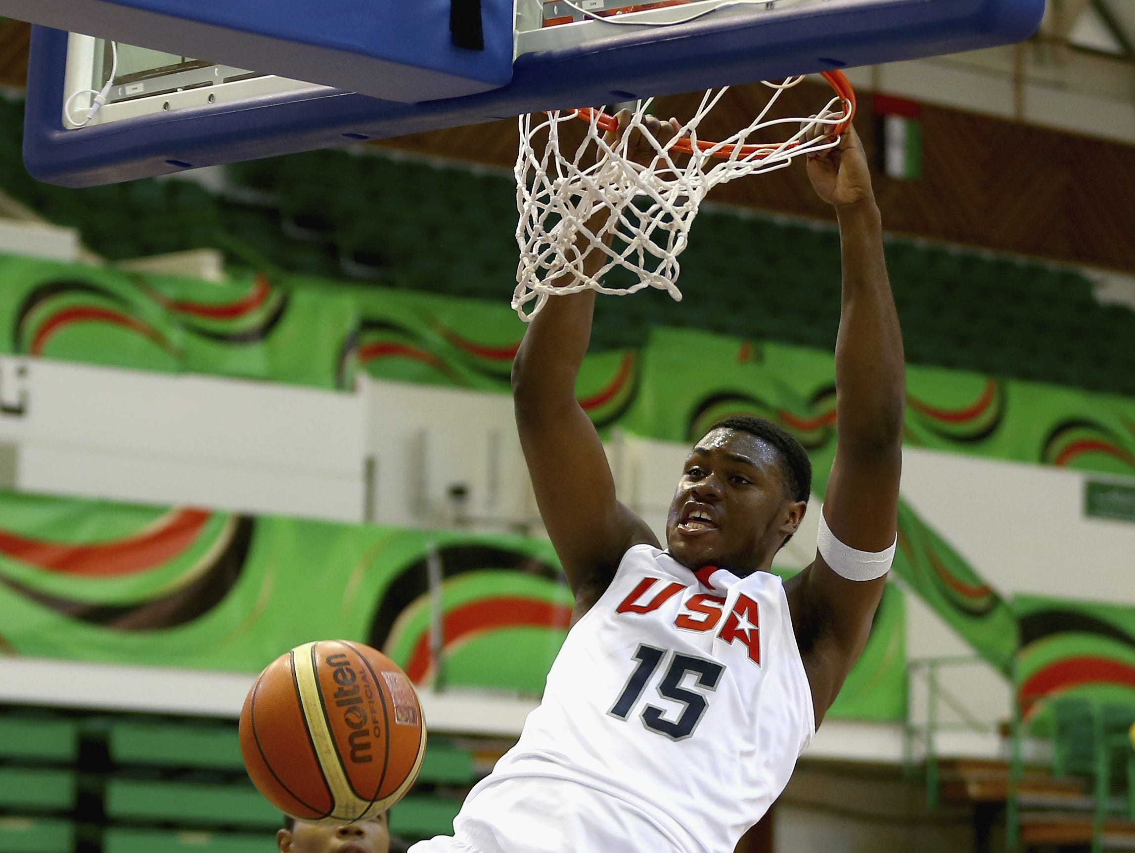 Diamond Stone of the United States shoots against Daniel Nnanna of Japan during the FIBA U17 World Championships Group Match between Japan and United States of America at Al Shabab Club on August 12, 2014 in Dubai, United Arab Emirates.