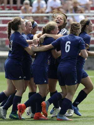 Bay Port players celebrate with Alexis Brunette after Brunette's goal against Muskego in a Division 1 semifinal match Thursday at the WIAA state girls soccer tournament at Uihlein Soccer Park in Milwaukee.