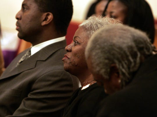 Paulette Warren listens as others speak about her son Larry-Jamaal Warren, during a memorial service at Bethel Baptist church in White Plains Feb. 15, 2008.( Frank Becerra Jr. / The Journal News )
