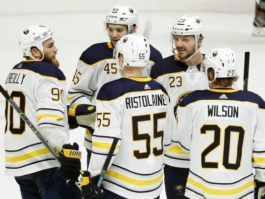 Buffalo Sabres center Sam Reinhart (23) is congratulated after scoring his third goal of the game, giving him a hat trick, in the third period of an NHL hockey game against the Nashville Predators Saturday, March 31, 2018, in Nashville, Tenn. The Sabres won 7-4. (AP Photo/Mark Humphrey)