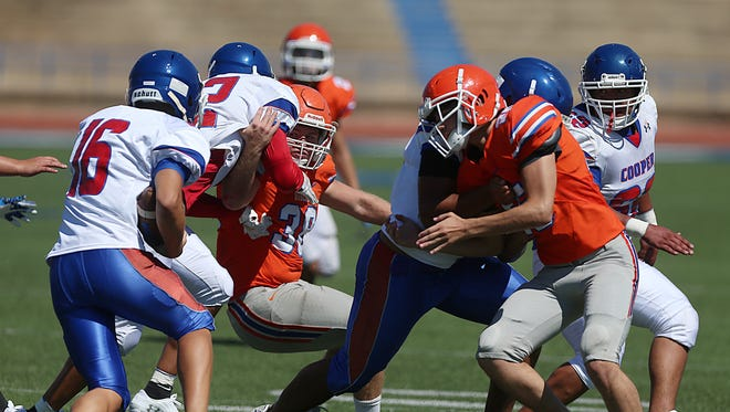 Central Bobcats face off against Abilene Cooper during a game of scrimmage at San Angelo Stadium Friday, August 24, 2018.