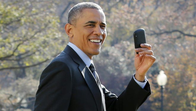 President Obama shows off his BlackBerry phone.
