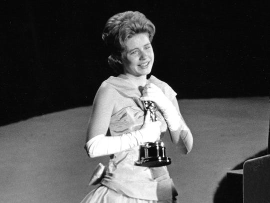 "Patty Duke, 16, accepts the Oscar as best supporting actress for her work in ""The Miracle Worker"" at the Academy Awards on April 8, 1963."