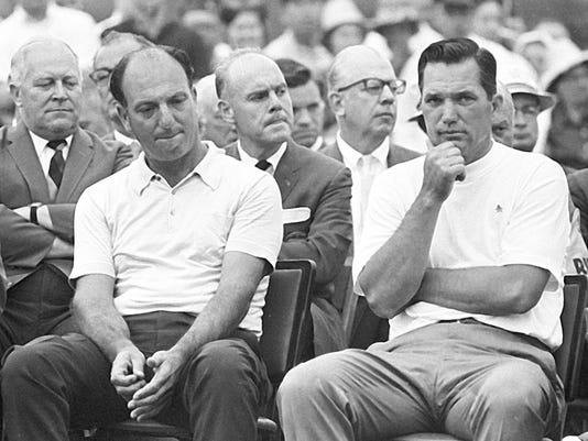 FILE - In this April 14, 1968, file photo, Roberto De Vicenzo, left, of Argentina, who turned in an erroneous scorecard and was pushed into second place, sits beside Masters winner Bob Goalby at Augusta National Golf Club in Augusta, Ga. De Vicenzo, known as much for a scorecard error at the Masters as his British Open victory that made him the first Argentine to win a major, died Thursday, June 1, 2017. He was 94. (AP Photo/File)